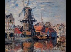 阿姆斯特丹运河旁的风车 莫奈.jpg