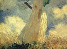 撑着太阳伞面向左边的女子 莫奈.jpg